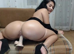 Asian girl rides on dildo