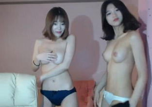 Two sexy asian girls dancing on cam