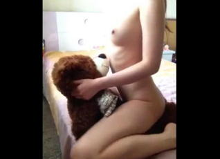 College asian chick grinding on plush bear