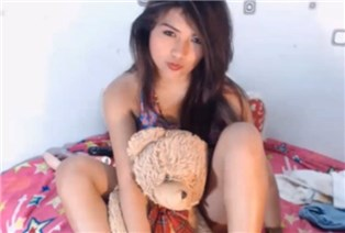 Cute babe teases with teddy bear