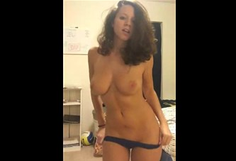 Curly brunette shows quick strip