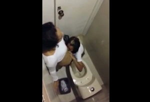 Horny latina girls has sex on the toilet <!-- width=