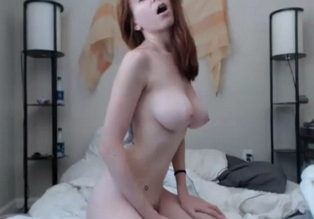 Redhead babe with big boobs plays with hitachi