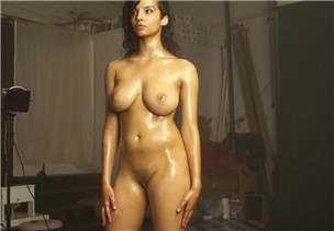 Busty Indian girl with oiled body on photoshoot