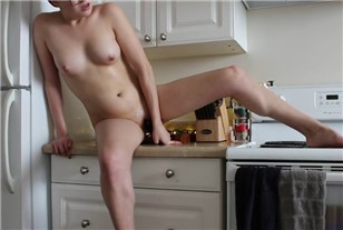 Girl plays with toy in the kitchen