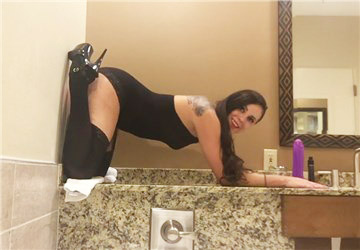 Girl in sexy lingerie fucks wall mounted dildo <!-- width=