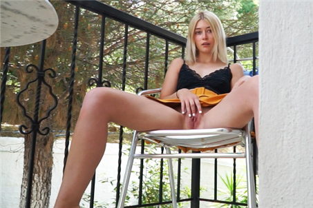 Naked blonde rubs pussy on balcony <!-- width=