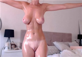 Busty blonde teases with oiled body