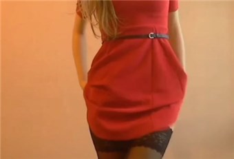 Sexy blonde in red dress shows striptease