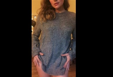 Cute girl in sweater shows her tits <!-- width=