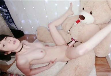 Hot girl rides dildo on teddy bear <!-- width=