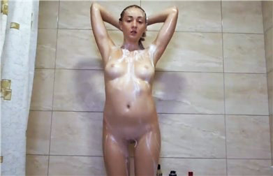 Slender brunette teases in the shower <!-- width=