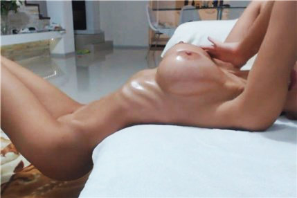 Sexy camgirl oiled her big boobs <!-- width=