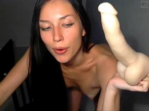 Naked horny brunette plays with two dildos