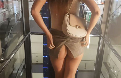 Girl fingering pussy in the elevator
