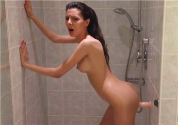 Sexy brunette fucking wall mounted dildo in the shower