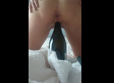 Polish girl rides on wine bottle