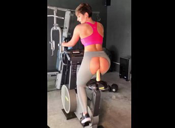 Sporty girl shows workout on bicycle!