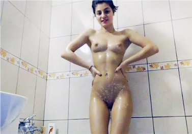 Sexy brunette showering with vibrating toy in pussy
