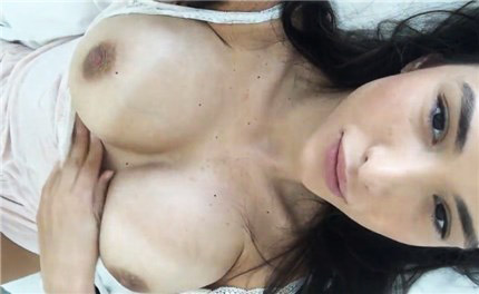 Busty Asian beauty selfshot teasing in the bed