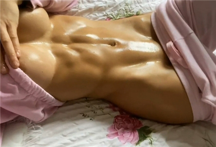 Girl shows her oiled sporty body <!-- width=