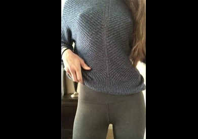 Brunette teasing in leggings and blue sweater <!-- width=