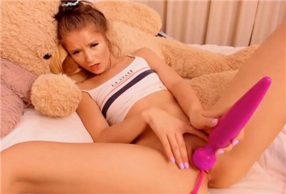 Pretty teen Little Sarah masturbates with vibrating toys