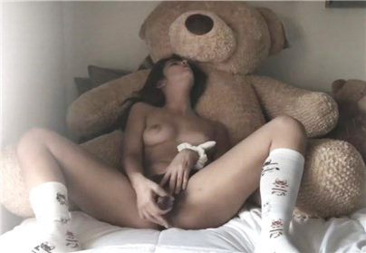 Brunette masturbates with teddy bear and glass dildo <!-- width=