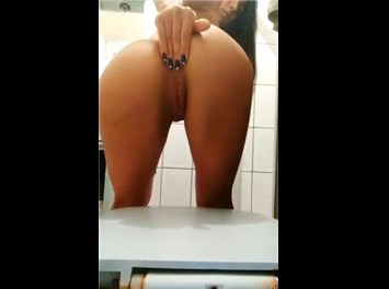 Brazilian beauty Jennifer Motta naked teases in the toilet <!-- width=