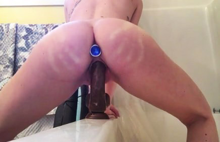 Riding on dildo in bathroom <!-- width=