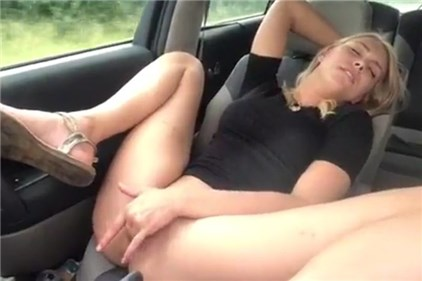 Hot blonde masturbation in a moving car <!-- width=