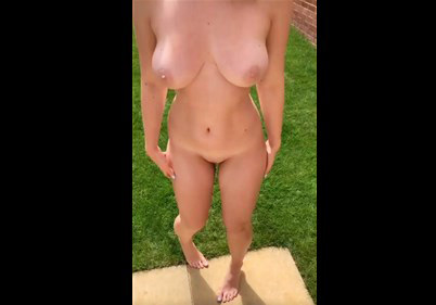 Skinny girl undressing and teases on the garden
