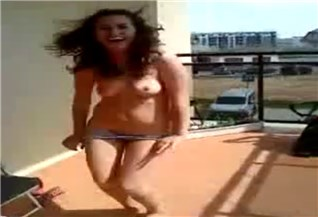 Funny girl to undress on the balcony