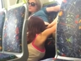 Girl licking girl in train