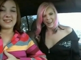 Amateur lesbians inside car in parking lot