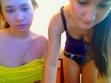 Two girls teasing on cam <!-- width=