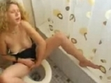 Blonde fingering pussy on toilet <!-- width=