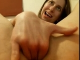 Girl rubs and uses glass toy on meaty pussy