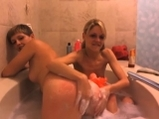 Two sexy girls in the tub