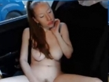 Busty girl masturbates in the car on public place