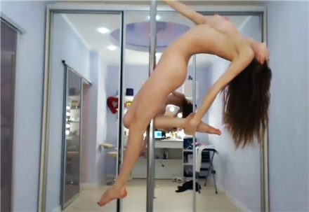 Three girls show strip show at the pole dance