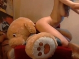 Teen with anal plug riding on teddy bear