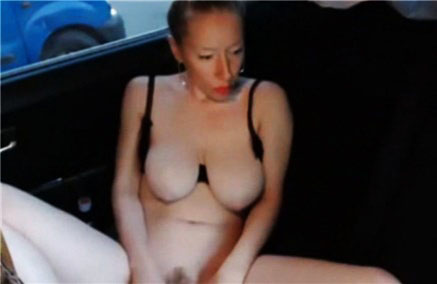 Busty girl in car plays with pussy in public parking