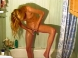 Sexy blonde shaves her pussy in shower <!-- width=