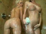 Two sexy girls take shower and wash each other