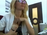 Blonde Optometrist flashing at work <!-- width=
