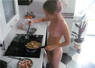 Slim girl naked cooking <!-- width=