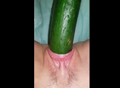 Horny girl closeup plays with cucumber <!-- width=