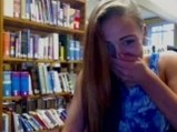 Young brunette teases with book on the library
