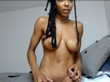 Busty black girl playing over a mirror